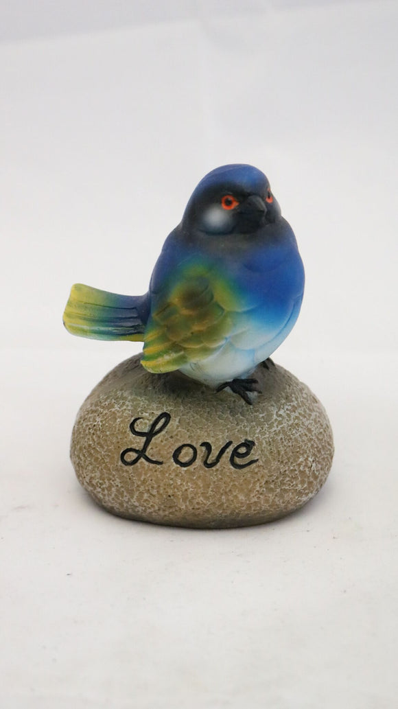 Inspirational Blue Bird Sitting on a Rock with the Word Love