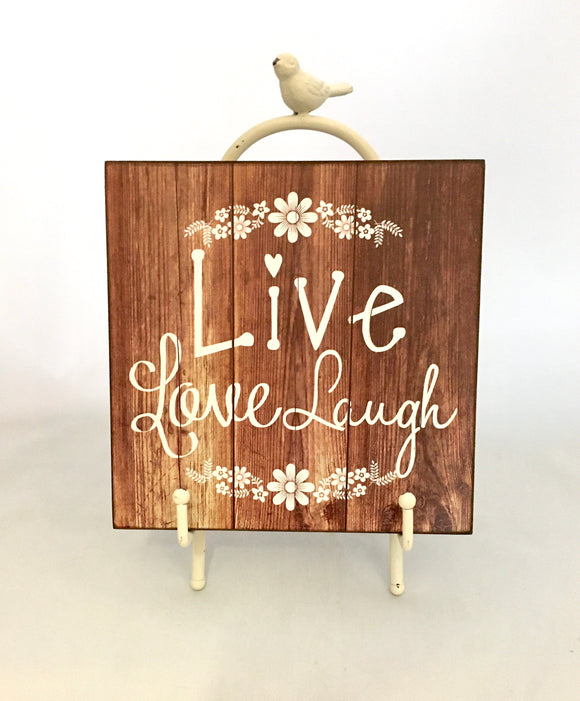 Live Love Laugh wooden sign with metal stand.