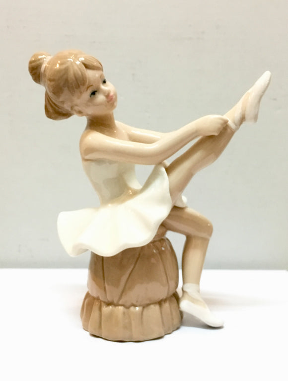 Sitting Cute Ballerina Figurine With White Dress Statue