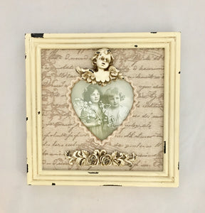 Vintage Look square frame with material and cherub decoration