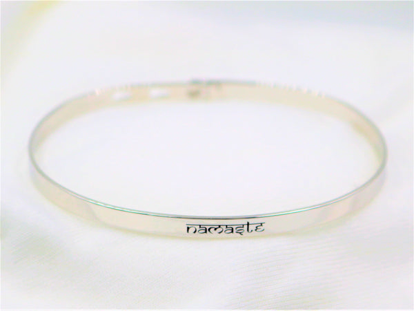 "Chelsea Taylor ""Namaste"" Adjustable Memory Bracelet, 3 Finishes - Bizzy Lizzy"