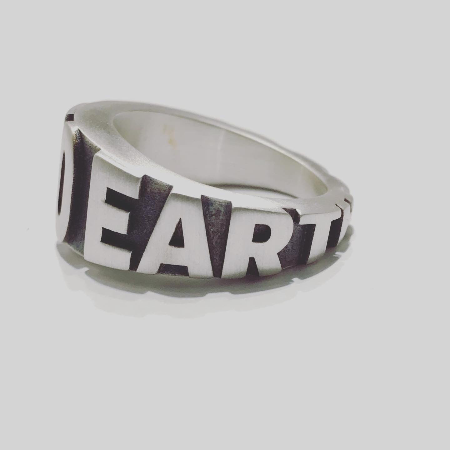 DOWN TO EARTH signet ring