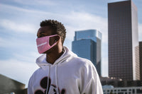 hypebeast hip hop dancer wearing pink tabi reversible path outdoor rave mask with streetwear apparel