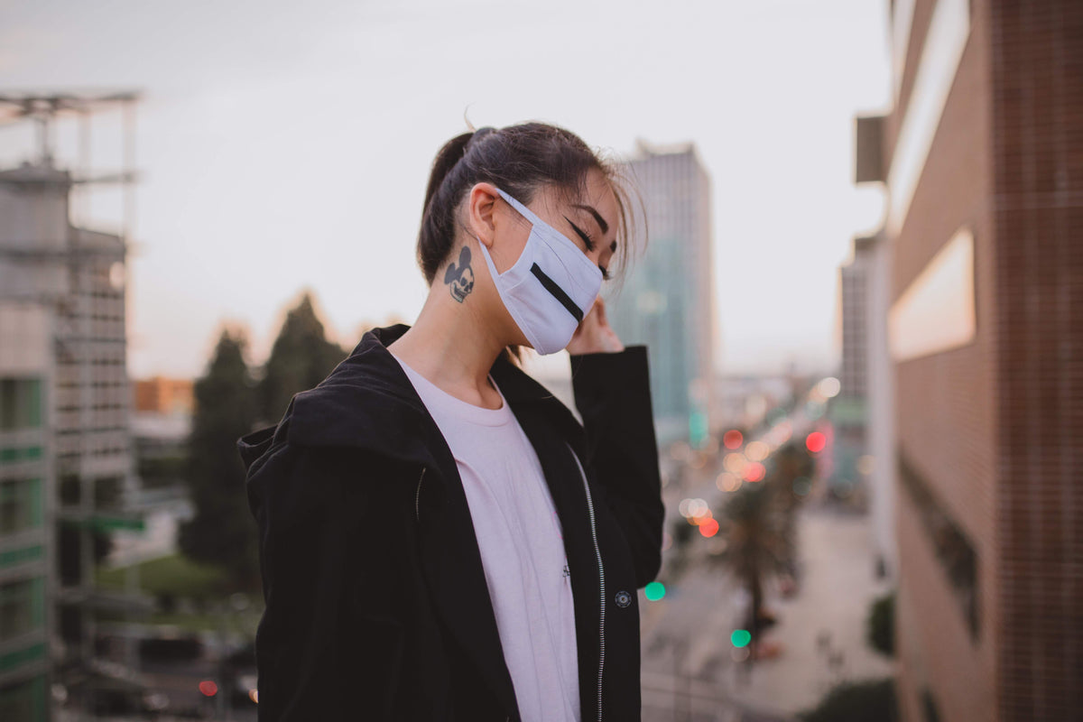 hypebeast girl with tabi outdoor rave path reversible white mask and streetwear apparel