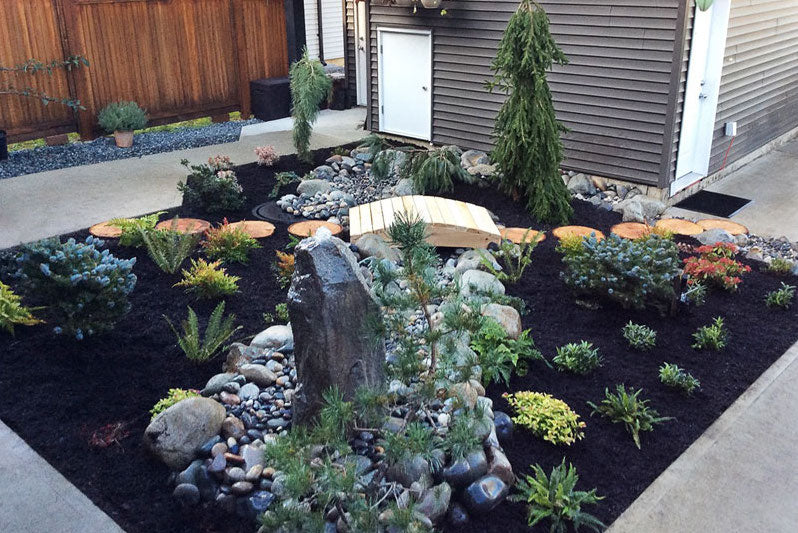 specialty landscaping, backyard with little bridge