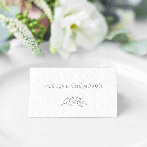 Wedding Place Card in light grey and white with minimal font style and hand drawn leaf element