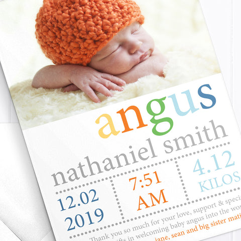 Baby boy birth announcement card with photo in bright bold colours