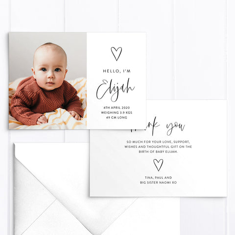 Double sided baby boy photo birth announcement card with large photo of baby, hand drawn love heart and modern script font in black and white