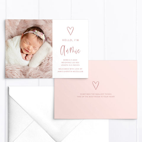 Modern baby girl photo birth announcement with large photo of baby and hand drawn love heart with birth details printed