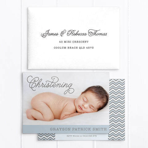 Traditional boy photo baptism invitation with cross and calligraphy in blue and chocolate brown, featuring calligraphy