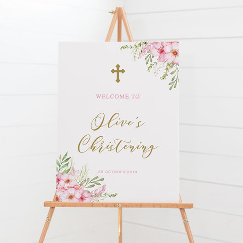 Baptism or Christening welcome sign features beautiful pink flowers and soft green leaves with modern calligraphy font