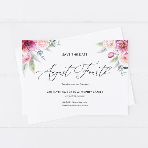 Modern wedding save the date card with pink florals in corners and calligraphy font
