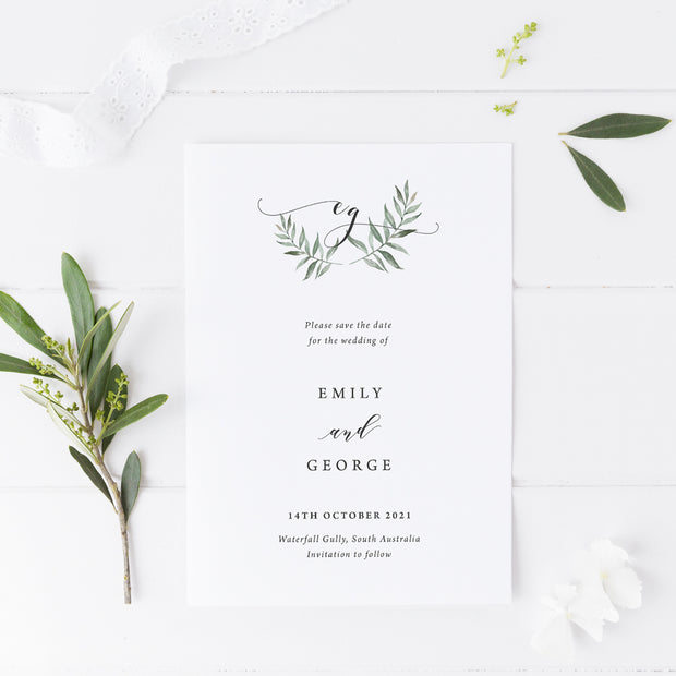Wedding save the date card, minimal style, green leaf wreath and monogram