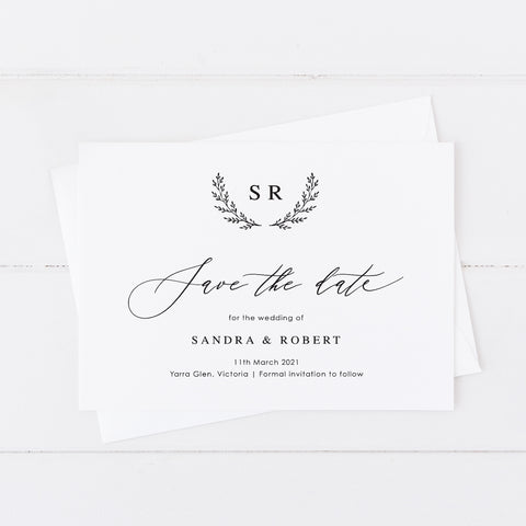 Wedding save the date card with wreath monogram of initials, black and white minimal style