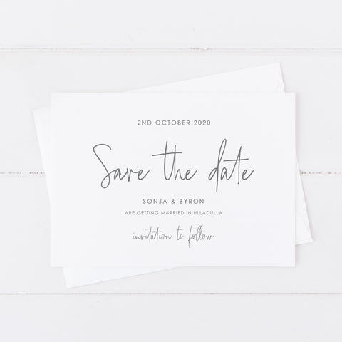 Simplistic wedding save the date card with matching invitation suite in grey and white