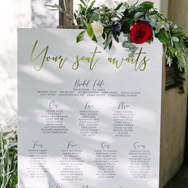 Beautiful wedding seating chart board with gold foil