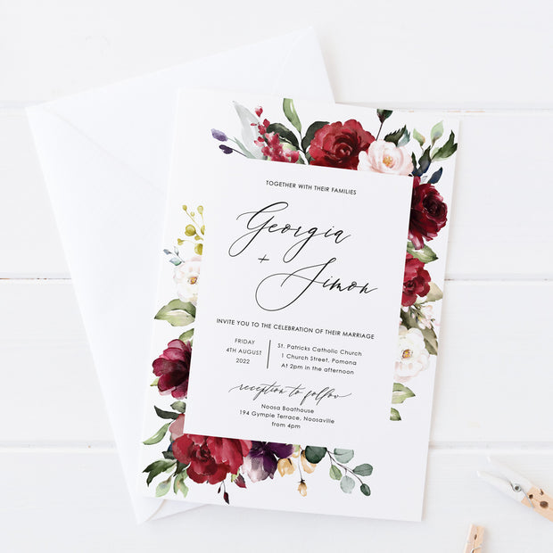 Wedding invitation, border of red florals and foliage and modern calligraphy font for names