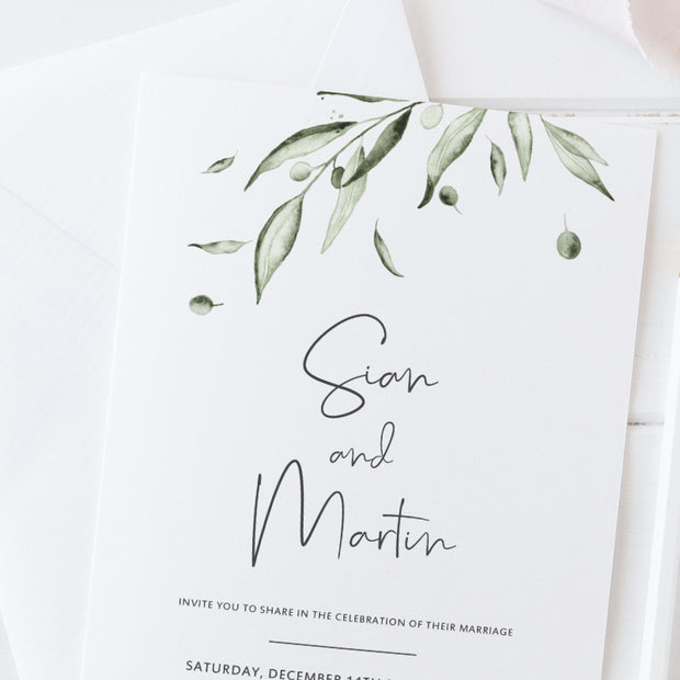 Greenery wedding invitation with watercolour olive leaves and soft green watercolour wash, modern calligraphy