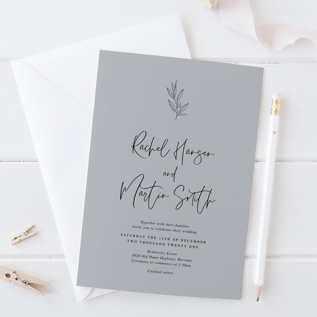 Wedding invitation on light grey cardstock with hand drawn olive leaf element