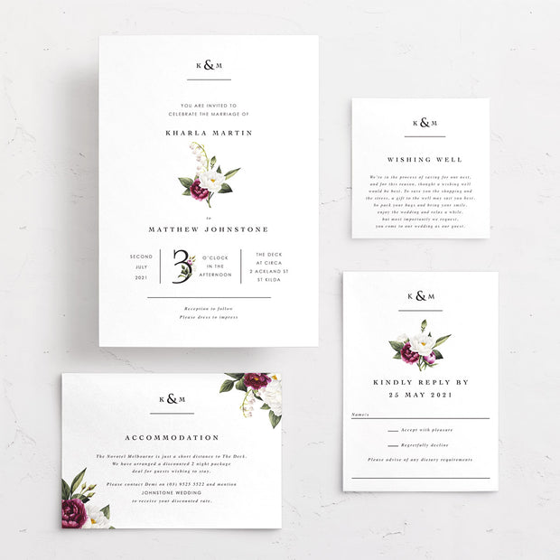 Professional wedding invitation with burgundy and white florals and initial monogram at top