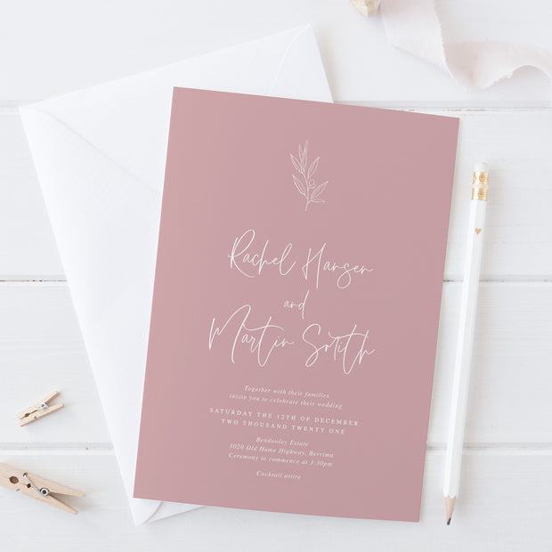 Wedding invitation on pink rose cardstock with hand drawn olive leaf element, white ink printing