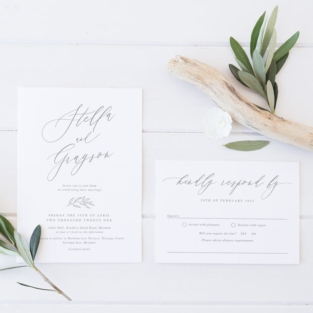 Natural wedding invitation with beautiful calligraphy and small botanical hand drawn leaf in minimal style