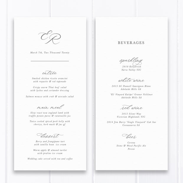 Traditional calligraphy wedding menu in grey and white with monogram of bride and grooms initials.