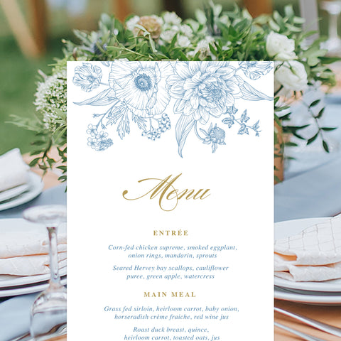 Hamptons inspired wedding menu in cornflower blue and gold with delicate hand drawn florals and gold calligraphy