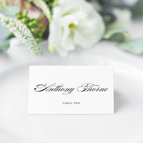 Black and white folded wedding place cards with calligraphy font