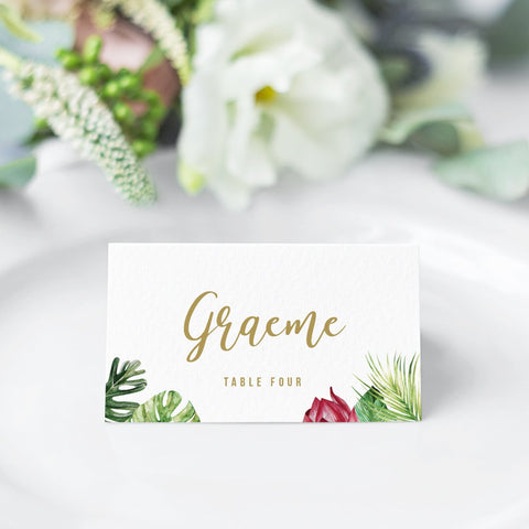 Wedding place cards with tropical watercolour leaves and flower, gold names