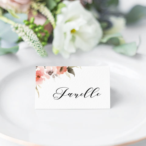 Calligraphy wedding place cards with flowers in corner in apricot and pink colours