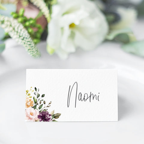Wedding place cards with bohemian florals in corner and modern hand written script font