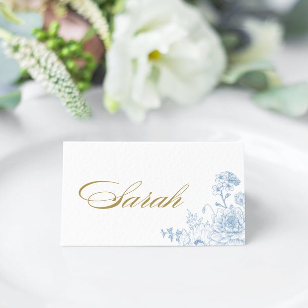 Elegant wedding place cards with delicate, detailed hand drawn floral line art in soft cornflower blue and gold