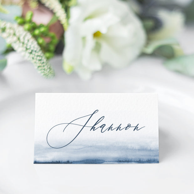 Wedding place card with navy blue watercolour wash and calligraphy font style