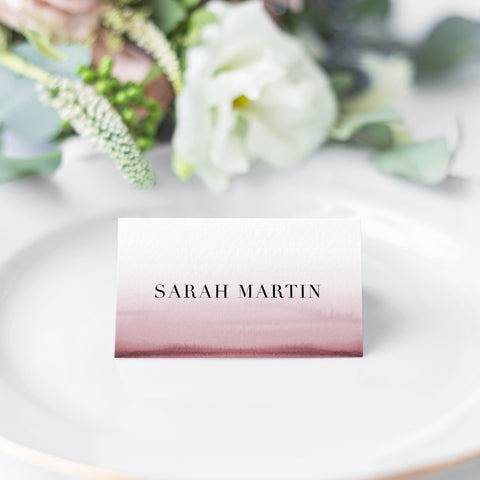 Folded wedding place cards with a stunning combination of a deep pink watercolour ombre and minimalistic font style.