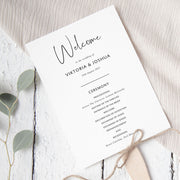 Minimal wedding ceremony program in charcoal and white with script font
