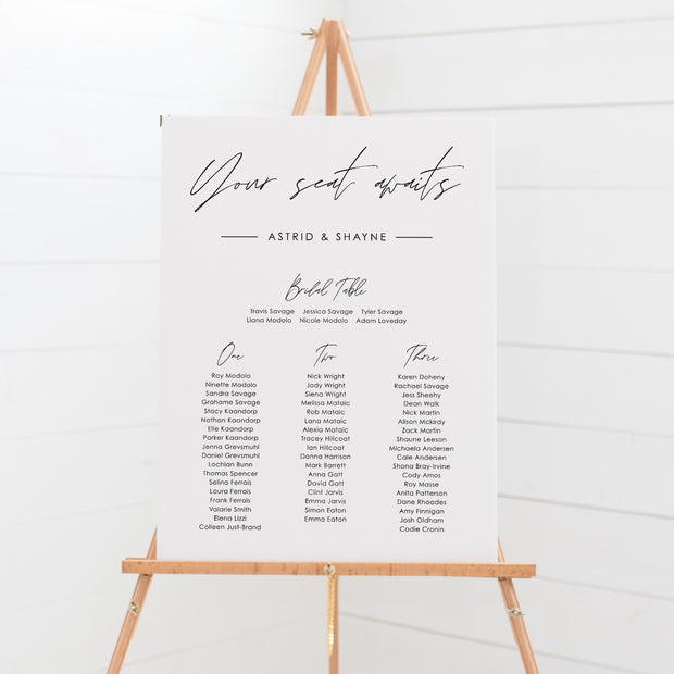 Wedding seating board with handwritten font, beautiful green leaves and white flowers, foamboard seating chart, printable seating plans