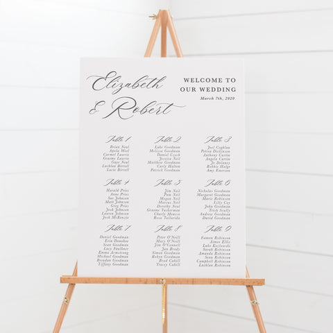 Wedding seating chart, guest name plan, features beautiful modern calligraphy font. Mounted to board for display on an easel.