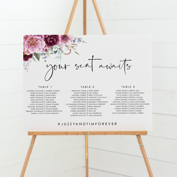 Wedding seating chart with burgundy and pink flowers and modern script font