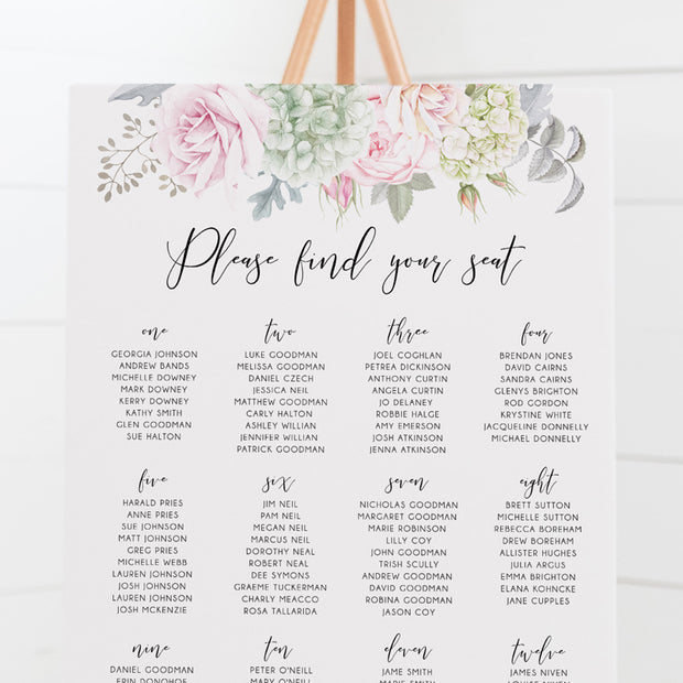 Wedding seating chart or guest name plan with calligraphy heading and soft pink flowers and greenery. Mounted to board for sitting on an easel.