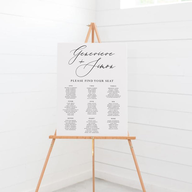 Wedding seating chart on board, black and white, large heading in script font