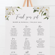 Wedding seating chart professionally designed with white corner florals andn modern script font