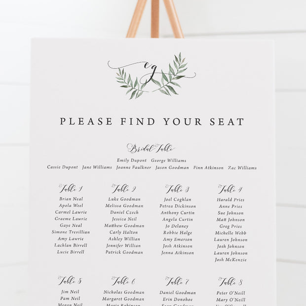 Wedding seating chart with monogram and leafy wreath at top