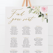 Floral wedding seating chart with pink and white flowers in the corner and gold calligraphy heading Find Your Seat.