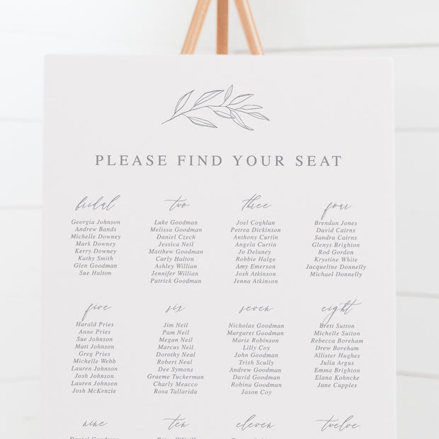 Botanical wedding seating chart in light grey and white with hand drawn leaf element