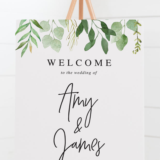 Wedding welcome sign with green leaves and modern script font