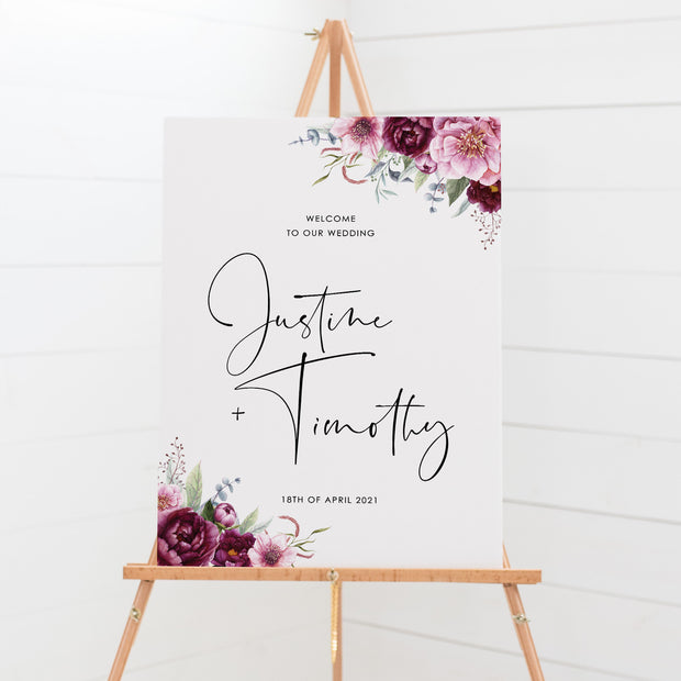 Wedding welcome sign board with pink, burgundy florals and foliage