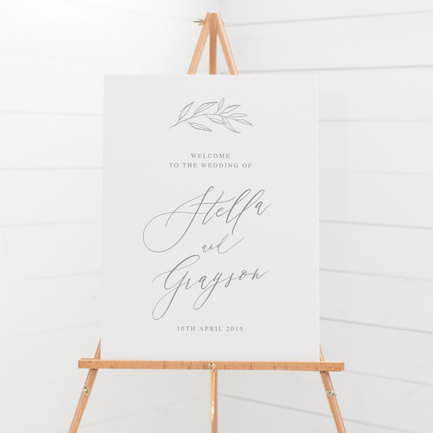 Botanical wedding welcome sign with hand drawn leaf in light grey and white. Calligraphy font.