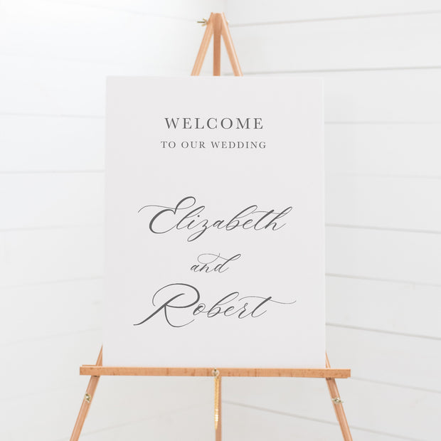 Traditional wedding welcome sign on board with calligraphy for the bride and grooms name.