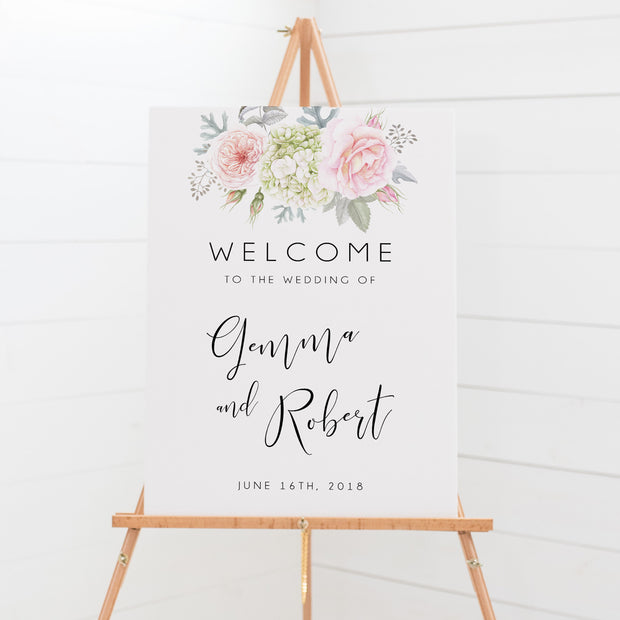 Wedding welcome sign board with pink and green florals and script font
